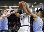 Northwestern guard Ryan Taylor, center, shoots against Columbia guard Jake Killingsworth, left, and forward Patrick Tape during the second half of an NCAA college basketball game Sunday, Dec. 30, 2018, in Evanston, Ill. Northwestern won 75-54. (AP Photo/Nam Y. Huh)