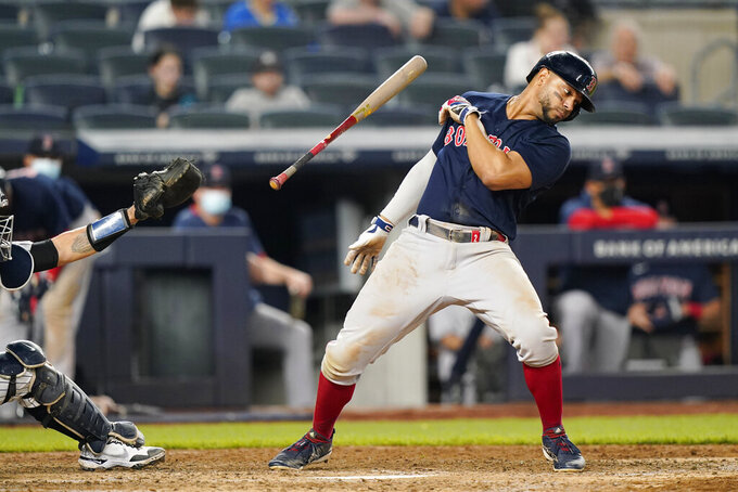 Boston Red Sox Xander Bogaerts loses his bat as he avoids a pitch during the sixth inning of a baseball game against the New York Yankees, Sunday, June 6, 2021, at Yankee Stadium in New York. (AP Photo/Kathy Willens)