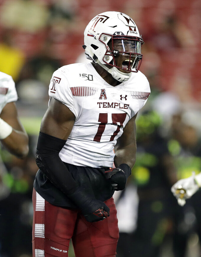 Temple defensive end Dana Levine (17) celebrates after sacking South Florida quarterback Jordan McCloud during the first half of an NCAA college football game Thursday, Nov. 7, 2019, in Tampa, Fla. (AP Photo/Chris O'Meara)