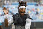 Carolina Panthers quarterback Cam Newton waves to the crowd during a Fan Fest practice at the NFL football team's training camp in Charlotte, N.C., Friday, Aug. 2, 2019. (AP Photo/Chuck Burton)