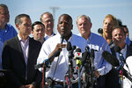 FILE - In this June 21, 2018 file photo, Columbia Mayor Steve Benjamin, center, speaks accompanied by a group of U.S. mayors during a news conference outside the holding facility for immigrant children in Tornillo, Texas, near the Mexican border.  Expressing frustration that police officers, charged with enforcing  South Carolina Gov. Henry McMaster's stay-at-home order during the coronavirus outbreak, are not being told which businesses have been granted permission to stay open, Benjamin said, on Friday, April 10, 2020 he was pursuing an open-records request to obtain the information.    (AP Photo/Andres Leighton, File)