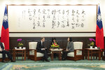 In this photo released by the Taiwan Presidential Office, William Brent Christensen, director of the American Institute in Taiwan eat right meets with Taiwan President Tsai Ing-wen, at left in the Presidential Office in Taipei, Taiwan. The Taiwanese president sat down with the top American official in Taipei on Sunday, one day after her landslide victory over challenger Han Kuo-yu of the opposition Nationalist Party.(Taiwan Presidential Office via AP)