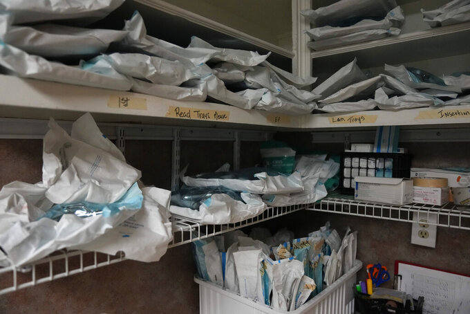 Sealed trays of surgical tools sit on storage shelves ahead of the arrival of women seeking abortions, Saturday, Oct. 9, 2021, in Shreveport, La. The nation's most restrictive abortion law is driving many women from Texas to seek services in neighboring states. (AP Photo/Rebecca Blackwell)