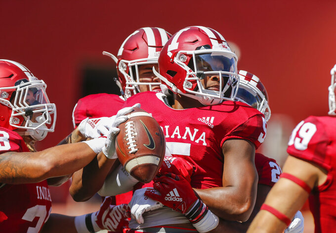 Indiana's J-Shun Harris (5) celebrates a touchdown against Ball State during an NCAA college football game, Saturday, Sept. 15, 2018 in Bloomington, Ind. (Jeremy Hogan/The Herald-Times via AP)