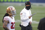 FILE - San Francisco 49ers head coach Kyle Shanahan stands on the sideline during the second half of an NFL football game against the Seattle Seahawks in Seattle, in this Sunday, Nov. 1, 2020, file photo. The 49ers are set to embark on an unusual three-week road trip after being kicked out of their home stadium and practice facility because of strict new COVID-19 protocols in their home county. (AP Photo/Scott Eklund, File)