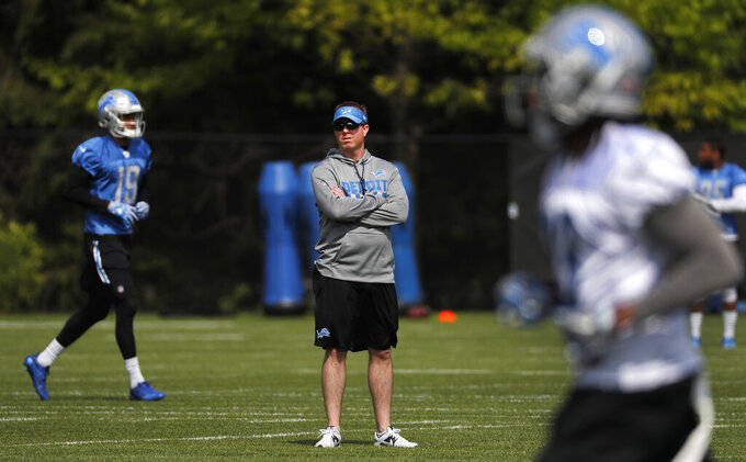 """FILE - In this May 24, 2017, file photo, Detroit Lions general manager Bob Quinn watches the NFL football team practice in Allen Park, Mich. """"Everyone that works in football and other professional sports sacrifices a lot of family time,"""" Detroit Lions general manager Bob Quinn said earlier this week. """"That is just the way it has always been."""" Unless, there's a pandemic.(AP Photo/Paul Sancya, File)"""