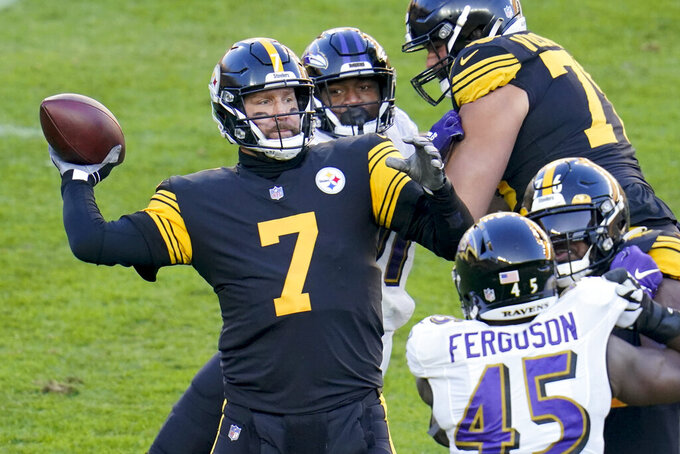Pittsburgh Steelers quarterback Ben Roethlisberger (7) passes as he is pressured by Baltimore Ravens defensive end Yannick Ngakoue (91), center, and linebacker Jaylon Ferguson (45) in the first half of an NFL football game, Wednesday, Dec. 2, 2020, in Pittsburgh. (AP Photo/Gene J. Puskar)