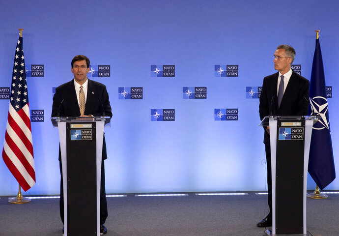 U.S. Secretary of Defense Mark Esper, left, and NATO Secretary General Jens Stoltenberg participate in a joint press conference at NATO headquarters in Brussels, Friday, June 26, 2020. U.S. Secretary of Defense Mark Esper is at NATO to follow-up on a broad range of issues raised during last week's NATO defense ministerial. (AP Photo/Virginia Mayo, Pool)