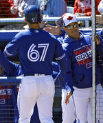 Toronto Blue Jays' Cavan Biggio (67) shakes hands with manager Charlie Montoya after Biggio hit a home run off Philadelphia Phillies starting pitcher Vince Valasquez during the second inning of a spring training baseball game Wednesday, March 6, 2019, in Dunedin, Fla. (AP Photo/Chris O'Meara)