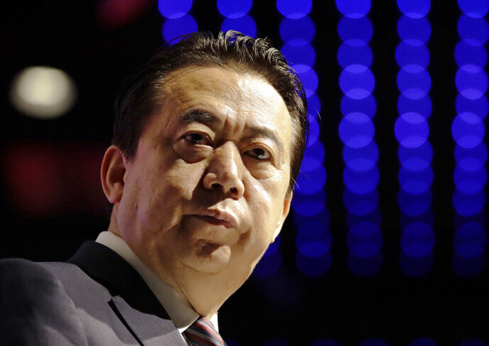 FILE - In this July 4, 2017, file photo, Interpol President Meng Hongwei delivers his opening address at the Interpol World Congress, in Singapore. China has sentenced the former president of Interpol Meng Hongwei to 13 years and six months in prison on charges of accepting bribes. (AP Photo/Wong Maye-E, File)