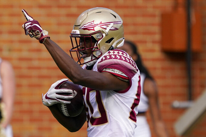 Florida State wide receiver Ontaria Wilson celebrates after scoring during the first half of the team's NCAA college football game against Wake Forest on Saturday, Sept. 18, 2021, in Winston-Salem, N.C. (AP Photo/Chris Carlson)