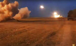 In this image taken from video released by Azerbaijan's Defense Ministry on Wednesday, Oct. 21, 2020, Azerbaijan's army artillery fire during fighting with forces of the self-proclaimed Republic of Nagorno-Karabakh. Azerbaijan's President Ilham Aliyev said that to end hostilities Armenian forces must withdraw from Nagorno-Karabakh. He has insisted that Azerbaijan has the right to reclaim its territory by force after nearly three decades of international mediation yielded no progress. (Azerbaijan's Defense Ministry via AP)
