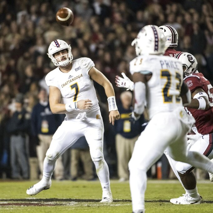 Chattanooga quarterback Nick Tiano (7) throws a pass to Tyrell Price (23) during the first half of an NCAA college football game against South Carolina Saturday, Nov. 17, 2018, in Columbia, S.C. (AP Photo/Sean Rayford)