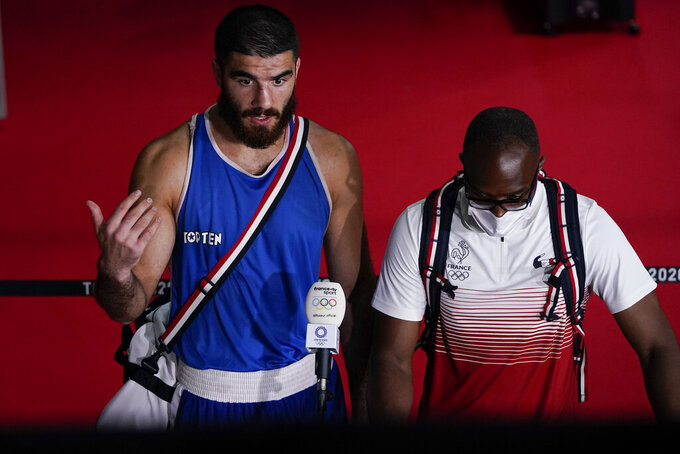 Eliad Mourad, of France, speaks to the media after a protest of his disqualification in a men's super heavyweight over 91-kg boxing match against Britain's Frazer Clarke at the 2020 Summer Olympics, Sunday, Aug. 1, 2021, in Tokyo, Japan. (AP Photo/Themba Hadebe)