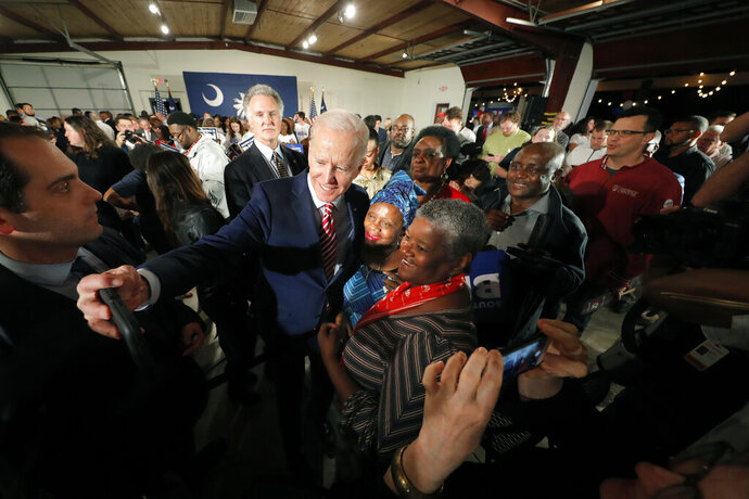 Democratic presidential candidate, former Vice President Joe Biden, takes photos with supporters after speaking at a campaign event in Columbia, S.C., Tuesday, Feb. 11, 2020. (AP Photo/Gerald Herbert)