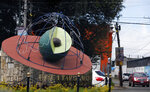 This Oct. 2, 2019 photo shows a sculpture of an avocado at the town's entrance in Ziracuaretiro, Michoacan state, Mexico. While Mexican avocado growers have for years lived in fear of assaults and shake downs, the situation went international in mid-August when a United States Department of Agriculture team of inspectors in Michoacan was