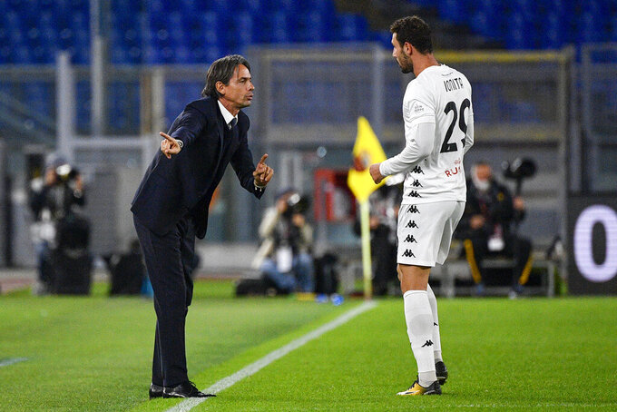 Benevento coach Filippo Inzaghi talks to player Artur Donita during the Italian Serie A soccer match between AS Roma and Benevento, at the Olympic stadium in Roma, Sunday, Oct. 18, 2020. (Fabrizio Corradetti/LaPresse via AP)