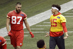 Kansas City Chiefs quarterback Patrick Mahomes (15) and tight end Travis Kelce (87) work out at NFL football practice Wednesday, Jan. 22, 2020 in Kansas City, Mo. The Chiefs will face the San Francisco 49ers in Super Bowl 54. (AP Photo/Charlie Riedel)