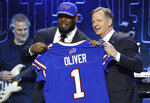 Houston defensive tackle Ed Oliver poses with NFL Commissioner Roger Goodell after the Buffalo Bills selected Oliver in the first round at the NFL football draft, Thursday, April 25, 2019, in Nashville, Tenn. (AP Photo/Steve Helber)
