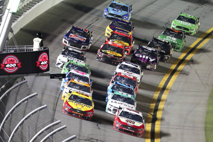 Joey Logano, front left, and Ryan Blaney, front right, lead the field near the end of Stage 2 of the NASCAR Cup Series auto race at Daytona International Speedway, Saturday, Aug. 28, 2021, in Daytona Beach, Fla. (AP Photo/David Graham)