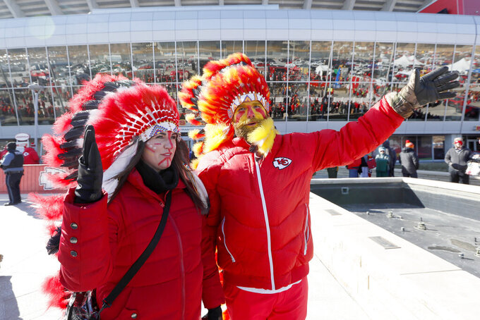FILE - In this Jan. 19, 2020, file photo, Kansas City Chiefs fans arrive before the NFL AFC Championship football game against the Tennessee Titans Sunday, in Kansas City, Mo. The Chiefs will prohibit the wearing of Native American headdresses, face paint and clothing at Arrowhead Stadium and are discussing the future of the iconic tomahawk chop as they address what many consider racist imagery associated with their franchise. (AP Photo/Charlie Neibergall, File)
