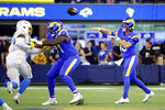 Los Angeles Rams quarterback Devlin Hodges throws during the first half of the team's preseason NFL football game against the Los Angeles Chargers on Saturday, Aug. 14, 2021, in Inglewood, Calif. (AP Photo/Ringo Chiu )