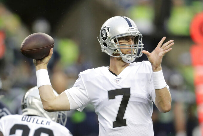 Oakland Raiders quarterback Mike Glennon (7) passes against the Seattle Seahawks during the first half of an NFL football preseason game Thursday, Aug. 29, 2019, in Seattle. (AP Photo/Stephen Brashear)