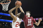 Saint Joseph's forward Taylor Funk (33) stops Davidson guard Carter Collins (24) from scoring during the first half of an NCAA college basketball game in the Atlantic 10 Conference tournament, Friday, March 15, 2019, in New York. (AP Photo/Mary Altaffer)