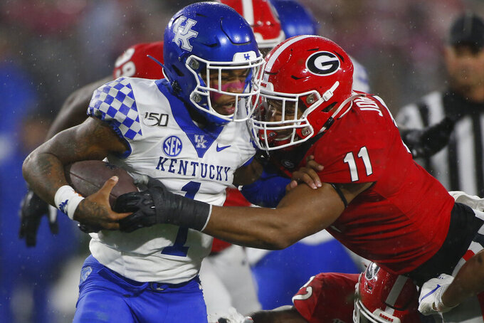 Georgia linebacker Jermaine Johnson (11) takes down Kentucky quarterback Lynn Bowden Jr. (1) during the first half of an NCAA college football game Saturday, Oct. 19, 2019, in Athens, Ga. (Joshua L. Jones/Athens Banner-Herald via AP)