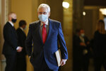 FILE - In this Tuesday, May 19, 2020, file photo, Senate Majority Leader Mitch McConnell, of Kentucky, wears a face mask to protect against the spread of the new coronavirus as he walks to the Senate chamber after meeting on Capitol Hill in Washington. Many states have yet to spend the federal funding they got more than a month ago to help with soaring costs related to the coronavirus crisis, making it tougher for states and cities to argue that they need hundreds of billions more from U.S. taxpayers. (AP Photo/Patrick Semansky, File)