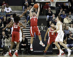 Alabama guard Riley Norris (1) pulls in a rebound in the second half of an NCAA college basketball game against Vanderbilt, Saturday, Feb. 9, 2019, in Nashville, Tenn. Alabama won 77-67. (AP Photo/Mark Humphrey)