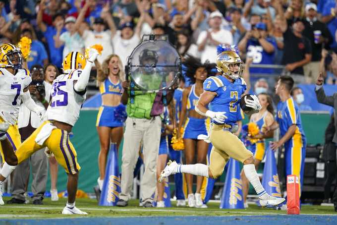 UCLA wide receiver Kyle Philips (2) scores against LSU during the second half of an NCAA college football game Saturday, Sept. 4, 2021, in Pasadena, Calif. (AP Photo/Marcio Jose Sanchez)