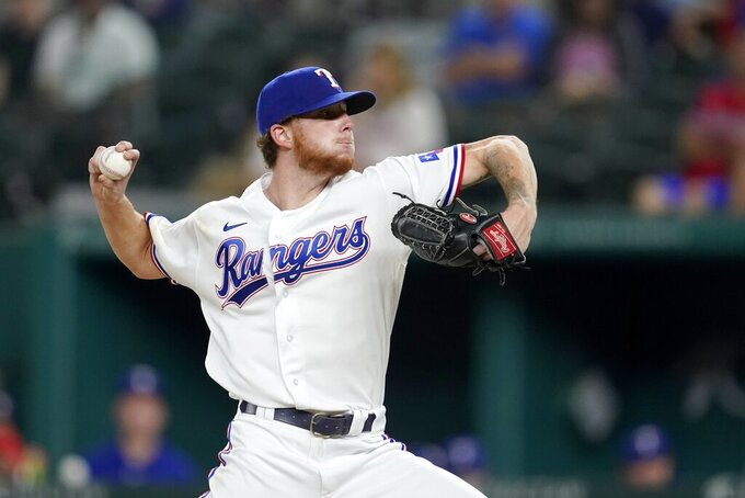 Texas Rangers starting pitcher A.J. Alexy throws in the fifth inning of a baseball game against the Colorado Rockies in Arlington, Texas, Monday, Aug. 30, 2021. Alexy made his major league debut in the game. (AP Photo/Tony Gutierrez)