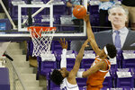 Texas forward Kai Jones (22) scores in front of TCU guard RJ Nembhard (22) during the second half of an NCAA college basketball game in Fort Worth, Texas, Sunday, March 7, 2021. (AP Photo/Michael Ainsworth)