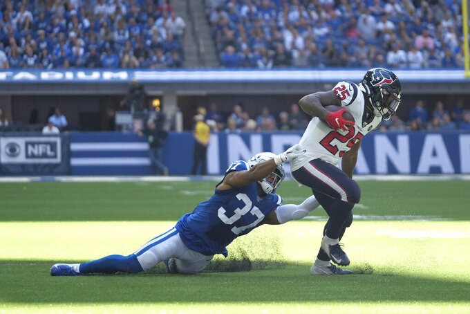 Houston Texans' Duke Johnson (25) runs out of a tackle of Indianapolis Colts' Khari Willis (37) during the first half of an NFL football game, Sunday, Oct. 20, 2019, in Indianapolis. (AP Photo/AJ Mast)