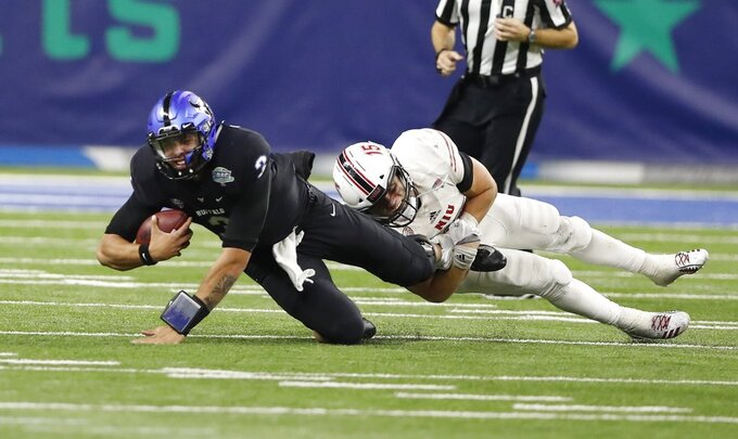 Buffalo quarterback Tyree Jackson (3) is sacked by Northern Illinois defensive end Sutton Smith during the second half of the Mid-American Conference championship NCAA college football game, Friday, Nov. 30, 2018, in Detroit. (AP Photo/Carlos Osorio)