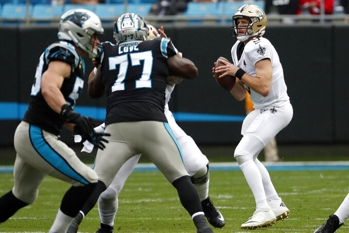 New Orleans Saints quarterback Drew Brees (9) looks to pass against the Carolina Panthers during the first half of an NFL football game in Charlotte, N.C., Sunday, Dec. 29, 2019. (AP Photo/Gerry Broome)