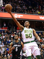 FILE - In this Tuesday, April 9, 2019, file photo, Boston Celtics guard PJ Dozier (50) goes to the basket past Washington Wizards forward Troy Brown Jr. (6) during the first half of an NBA basketball game in Washington. Christian Dawkins, a  former recruiter for a professional sports agent, denied on Wednesday, May 1, 2019, allegations that he paid a $2,500 bribe to then-University of South Carolina assistant Lamont Evans. He told a federal jury that the money was meant to pay expenses for the family of South Carolina basketball player P.J. Dozier, a top NBA prospect at the time.   (AP Photo/Nick Wass)