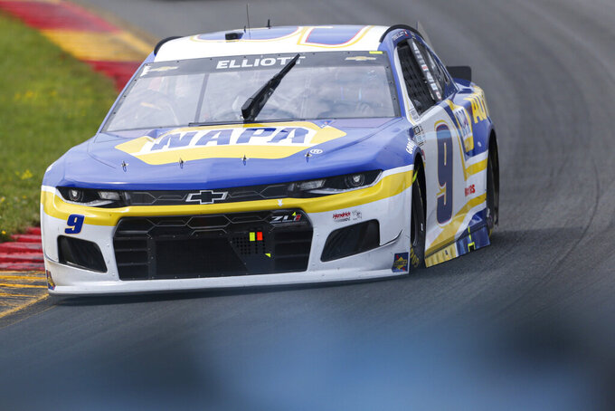 Chase Elliott turns into the Esses during a NASCAR Cup Series auto race in Watkins Glen, N.Y., on Sunday, Aug. 8, 2021. (AP Photo/Joshua Bessex)