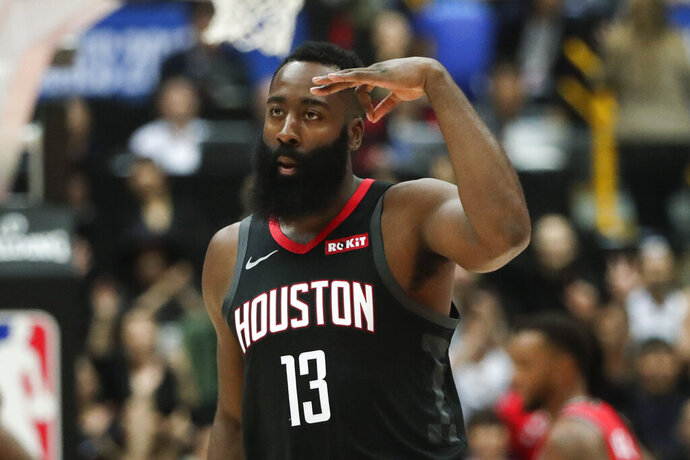 Houston Rockets' James Harden celebrates his three-point basket during the first half of an NBA preseason basketball game against the Toronto Raptors Tuesday, Oct. 8, 2019, in Saitama, near Tokyo. (AP Photo/Jae C. Hong)