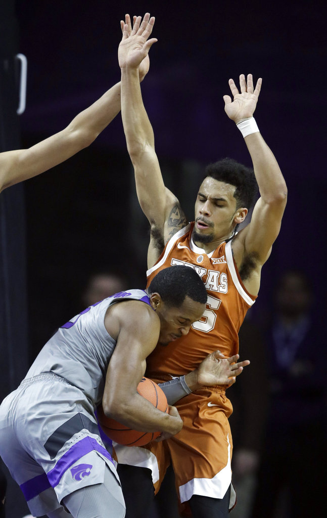 Texas pulls away from short-handed Kansas State, 67-47