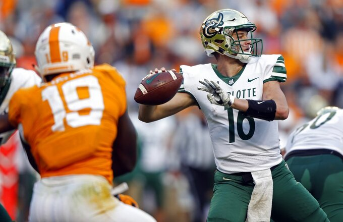 Charlotte quarterback Evan Shirreffs (16) throws to a receiver in the second half of an NCAA college football game against Tennessee Saturday, Nov. 3, 2018, in Knoxville, Tenn. Tennessee won 14-3. (AP Photo/Wade Payne)