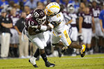 Texas A&M wide receiver Ainias Smith (0) is tackled by Kent State safety C.J. Holmes (29) after making a catch during the first half of an NCAA college football game on Saturday, Sept. 4, 2021, in College Station, Texas. (AP Photo/Sam Craft)