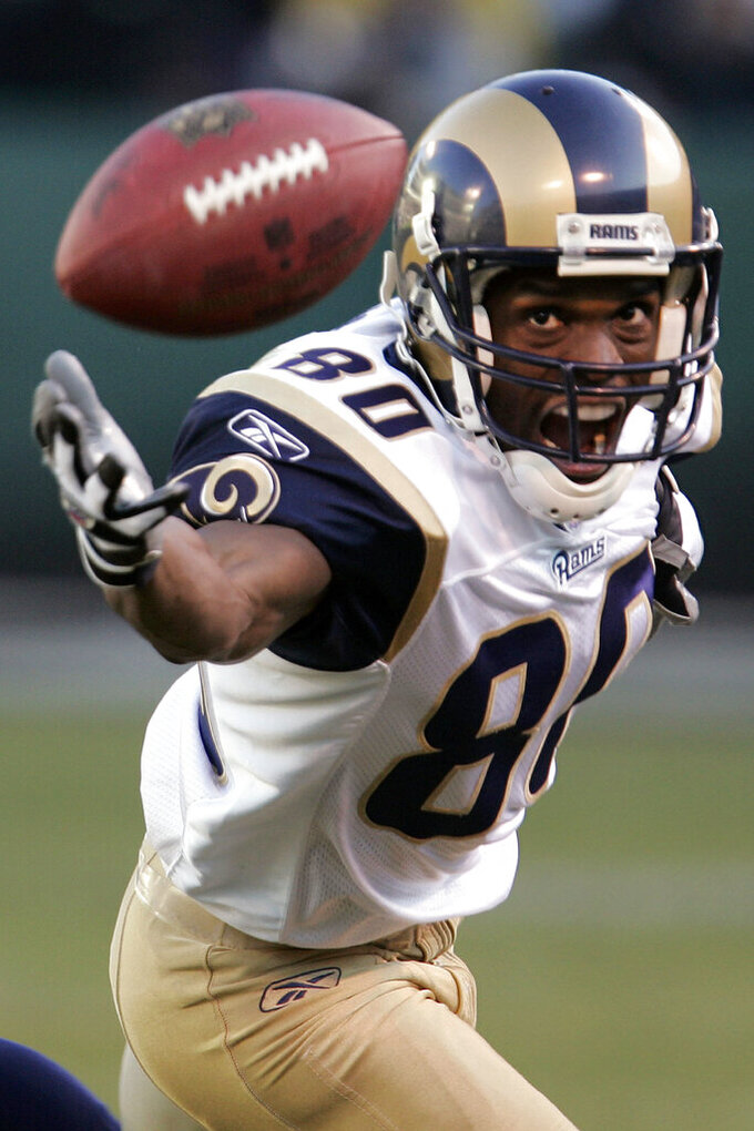 FILE - In this Dec. 17, 2006, file photo, St. Louis Rams wide receiver Isaac Bruce (80) eyes the football in the third quarter against the Oakland Raiders during their NFL game in Oakland, Calif. Bruce caught 1,024 passes for 15,208 yards and 91 touchdowns in 16 NFL seasons, including 14 with the Rams. He ranks 13th in league history in receptions, fifth in receiving yards and 12th in receiving scores. (AP Photo/Paul Sakuma, File)