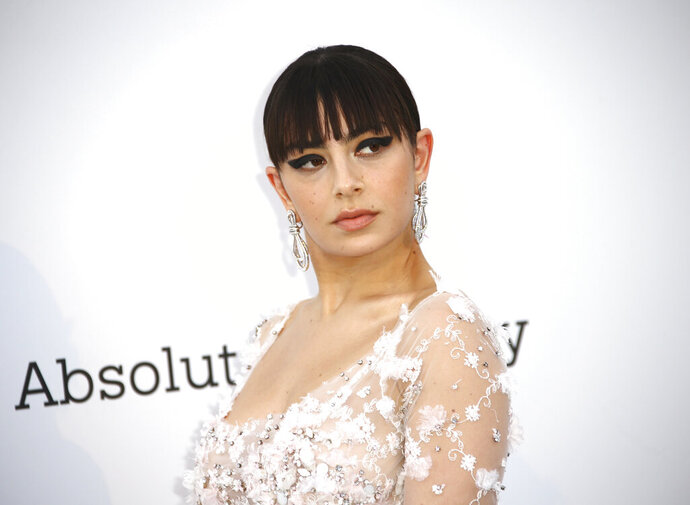 Singer Charli XCX poses for photographers upon arrival at the amfAR, Cinema Against AIDS, benefit at the Hotel du Cap-Eden-Roc, during the 72nd international Cannes film festival, in Cap d'Antibes, southern France, Thursday, May 23, 2019. (Photo by Joel C Ryan/Invision/AP)