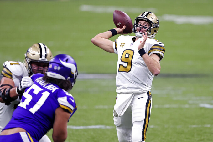 New Orleans Saints quarterback Drew Brees (9) passes as offensive tackle Ryan Ramczyk (71) blocks Minnesota Vikings defensive tackle Hercules Mata'afa (51) in the first half of an NFL football game in New Orleans, Friday, Dec. 25, 2020. (AP Photo/Butch Dill)