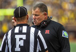 Rutgers head coach Greg Schiano speaks with a sideline official in the first quarter of an NCAA college football game against Michigan in Ann Arbor, Mich., Saturday, Sept. 25, 2021. (AP Photo/Tony Ding)
