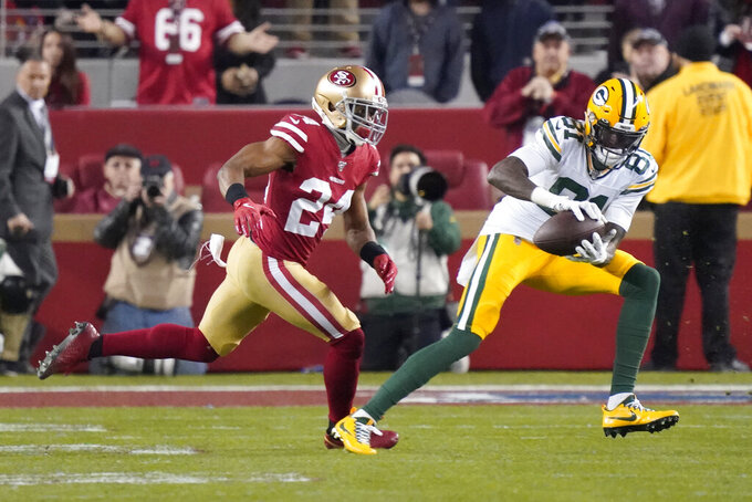File-This Jan. 19, 2020, file photo shows Green Bay Packers wide receiver Geronimo Allison (81) catching a pass in front of San Francisco 49ers defensive back K'Waun Williams (24) during the second half of the NFL NFC Championship football game  in Santa Clara, Calif.  The Detroit Lions have agreed to terms with Allison. The 26-year-old Allison comes to Detroit from division rival Green Bay.(AP Photo/Tony Avelar, File)