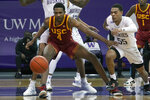 FILE - In this Thursday, Feb. 11, 2021 file photo, Southern California forward Evan Mobley (4) keeps his eye on the ball as Washington guard Quade Green (55) chases during an NCAA college basketball game in Seattle. Mobley has morphed into one of the best big men in college basketball for Southern California, back in the NCAA Tournament for the first time since 2017. The sixth-seeded Trojans (22-7) face the winner of a play-in game between No. 11 seed Drake and Wichita State on Saturday, March 20, 2021 in Indianapolis. (AP Photo/Ted S. Warren, File)