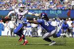 Buffalo Bills quarterback Josh Allen, left, evades New York Giants' Markus Golden during the second half of an NFL football game, Sunday, Sept. 15, 2019, in East Rutherford, N.J. (AP Photo/Adam Hunger)